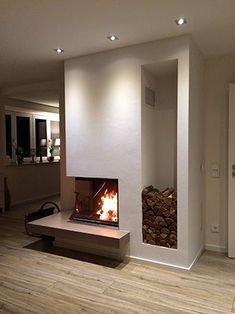 Corner fireplace with wood niche Home Fireplace, Modern Fireplace, Living Room With Fireplace, Fireplace Mantels, Corner Fireplaces, Fireplace Outdoor, Fireplace Feature Wall, Fireplace Gallery, Diy Interior