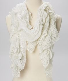 """Toss this scarf on for a touch of texture! With lovely lace and a gorgeous waterfall of crocheted ruffles, this scarf is perfect for rocking a romantic style.16"""" x 60""""100% acrylicHand wash; dry flatImported"""