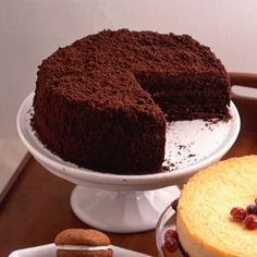 BLACKOUT CAKE (Ebinger's of Brooklyn style!) Chocolate Pudding: 2 tbsp. margarine or butter 3 oz. semisweet chocolate 2 oz. unsweetened chocolate 0.67 c. sugar 6 tbsp. cornstarch 3 tbsp. unsweetened cocoa 2.25 c. whole milk 2 large eggs 2 tsp. vanilla extract Chocolate Cake: 0.67 c. unsweetened cocoa 1.50 c. all-purpose flour 1.50 tsp. baking powder 0.50 tsp. baking soda 0.25 tsp. salt 0.75 c. whole milk 1.50 tsp. vanilla extract 1.50 c. sugar 0.75 c. margarine or butter 3 large eggs
