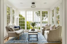 Custom builders John Kraemer & Sons built this lakeside coastal-inspired home that oozes luxury, comfort, and elegance. Palladian Window, French Colonial, Country French, Country Farm, Floor To Ceiling Windows, Living Room With Fireplace, Residential Architecture, Modern Architecture, French Doors