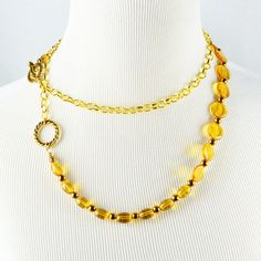 Live the drama with an adjustable double-wrap golden glass beaded necklace a full 40 inches long. Or give it to your favorite fashion adventurer. This endlessly adjustable necklace can be worn in an almost infinite variety of arrangements. Gold finish cha