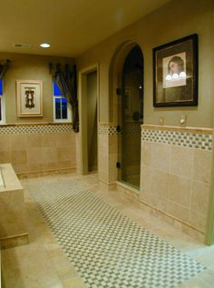 Arched doorway into walk-in shower