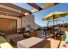 West Hollywood rooftop deck with kitchen and grilling area and an outdoor living area