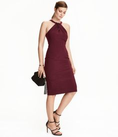 Burgundy. Knee-length halterneck dress in woven fabric. Narrow-cut with opening at top and a concealed zip and slit at back. Lined at top.