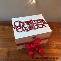 White wooden Christmas Eve Box with red glitter topper - make every child or adult's Christmas wishes come true! Wooden Christmas Eve Box, Christmas Wishes, White Christmas, Red Glitter, Wooden Boxes, Goodies, Christmas Decorations, Gift Wrapping, How To Make