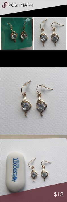 Lovely CZ Earrings in Gold Wow that hot date in your lil' black dress and these glitzy gold stunners! Jewelry Earrings
