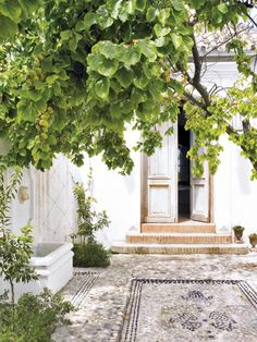 House in Malaga, Spain. (this is gorgeous, but Malaga is one of my least favourite towns in Spain. Outdoor Rooms, Outdoor Gardens, Outdoor Living, Exterior Design, Interior And Exterior, Landscape Design, Garden Design, Pebble Mosaic, Pebble Floor