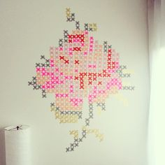 Washi tape cross-stitched rose wall art.  Photo by mariana_somuchlove