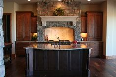 Parker New Home Construction – Medallion Cabinetry: Brookhill door style, Harvest Bronze on Knotty Alder & Hartford door style, Walnut on Knotty Alder