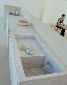 The World's Most Beautiful Kitchen Sinks. This marble sink is genius. One level gets the dishes out of immediate sight, or is the perfect place to drain recently washed vegetables. Gorgeous.