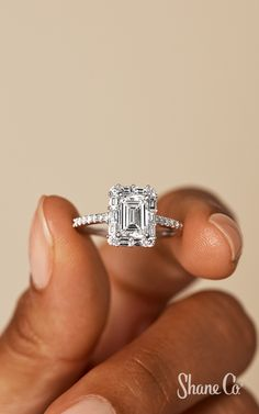This gorgeous halo engagement ring features 10 baguette diamonds (approx. carat TW), and 34 round diamonds (approx. carat TW) encompassing the center em Dream Engagement Rings, Classic Engagement Rings, Round Diamond Engagement Rings, Engagement Wedding Ring Sets, Baguette Engagement Ring, Country Engagement, Engagement Pictures, Engagement Shoots, Engagement Photography