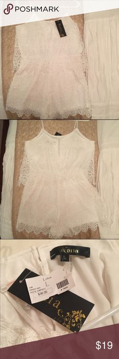 Katia white lace romper/play suit size- Large Crisp white lace romper from A local boutique,  Lotus. NWT. Has lining on the inside as well as adjustable straps. Has an overlay to the waist. Also, a little keyhole detail with a button in the back. Katia Other