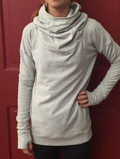 lululemon stress less hoodie I have a sweater like this (full turtle neck, longish at the waist with spandex) I wear it all the time. One of my favorite pieces of clothing.