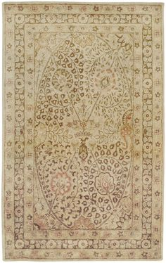 This hand tufted rug from the Vintage Collection by Surya features plush pile and sheen in soft brown and gold hues with a wonderfully classic floral pattern. (VTG-5202)