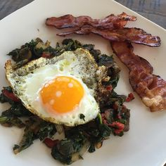 """""""Later gram of my breakfast. Eggs like this are my . Crispy from coconut oil in a cast iron skillet. Then you dip bacon in the yolk and cry because it's just so good.  Nestled on a bed of spinach, mushrooms, onions and sweet peppers all sprinkled with @dianesanfilippo savory spice blend from #PracticalPaleo. #Paleo #primal #paleodiet #paleohope #paleomom #paleobreakfast #paleolifestyle #cleaneating #dairyfree #glutenfree #grainfree #soyfree #freerangeeggs  #eatreal"""