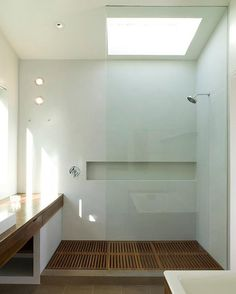 This shower looks cool, but the table to the left will get wet and by time; stained and ruined. A big shower is essential though! Maybe two tropical shower heads?
