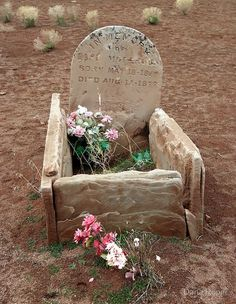 Grave of a small child in an old cemetery near the abandoned Silver Reef Mine in southern Utah.