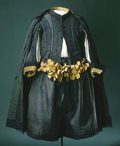 1658 suit in black silk (rips). The trousers are decorated with yellow silk ribbons tied into bows.  Worn by Karl X. Gustav of Sweden