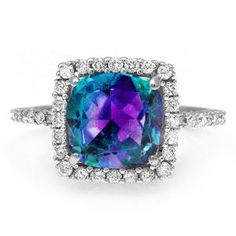 1) 8mm cushion-cut Lab-Created Alexandrite center stone in a prong setting.