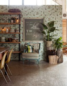 Room dividing. love the retro wallpaper and chair with the loft setting. Humming birds wallpaper by Cole & Son