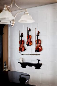 Music room wih some instruments on display. Not sure how easily a horn would hang on the wall?