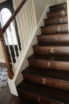 brown steps, white balusters