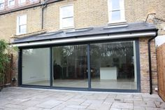 Large rear kitchen extension with sliding panelled doors, South West London Glass Extension, Rear Extension, Extension Ideas, Kitchen Extension Side Return, Contemporary Garden Rooms, Conservatory Extension, Patio Windows, House Extensions, Architecture