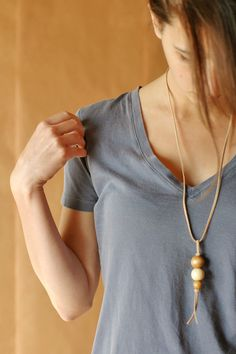 Simple DIY necklace w/ wood beads. Get your leather cording and beads at www.fizzypops.com.