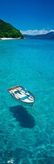 Crystal Clear Waters. The boat looks like it's floating on air.