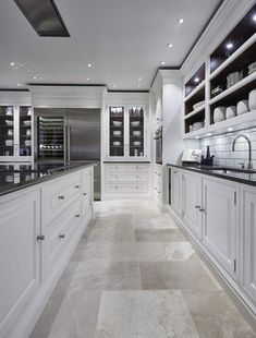 Luxury Kitchen Luxury Grand Kitchen - Tom Howley - Grand white painted kitchen with statement monochrome island featuring the latest state-of-the-art Sub-Zero and Wolf appliances. Grand Kitchen, Big Kitchen, Home Decor Kitchen, Kitchen Ideas, Kitchen Inspiration, Kitchen Modern, Kitchen White, Kitchen Layout, Rustic Kitchen