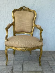 Vintage Gilt French Style Upholstered Arm Chair Hollywood Regency Glam. $295.00, via Etsy.