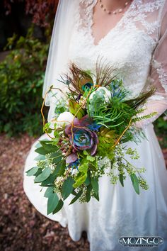 Bride request: Woodland theme (with succulents, seeded eucalyptus, fern, peonies, waxflower, baby's breath, blue thistle, green ball dianthus, curly willow and peacock feathers). Greenlife wedding specialist Shannon was completely inspired by the bride's vision!