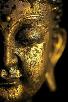 Buddha statue, chipping away in a graceful beauty.