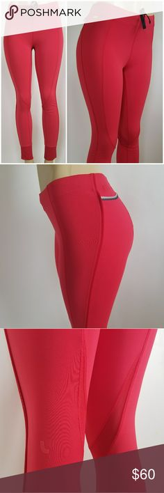 LOLЁ Leggings These essential Lolë leggings are the ideal garment for your indoor and outdoor activities. Breathable mesh inserts guarantee total comfort, while modern stretchy fabric makes for a decidedly athletic yet feminine look. They integrate Lolë's moisture-wicking, four-way stretch fabric with UPF 50+ protection. Like new  • Shaped fit with mid rise  • One zippered pocket and one self-pocket at back  • Coolmax® lined gusset  • Reflective logo Lole Pants Leggings