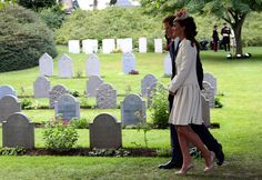 Britain's Prince Harry and Catherine, Duchess of Cambridge arrive at St. Symphorien Military Cemetery in Mons, Aug. 4, 2014.