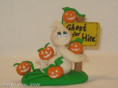 Ghost For Hire  By: Betty's Cutie Stuff  Halloween Polymer Clay Figurine Glow in the dark ghost hand sculpted.