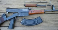 Somebody took the receiver of an SKS, and slapped it onto the lowers of an FAL (which was based on the SKS). The action is now rugged and smooth like the SKS, and has the comfort of an AK47. Also takes AK magazines. WANT. SO BADLY.