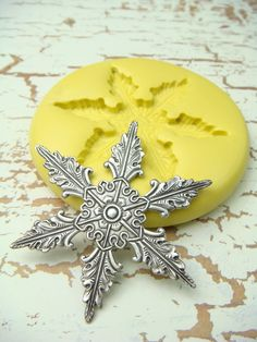 Snowflake (design 1)  - Flexible Silicone Mold - Push Mold, Jewelry Mold, Polymer Clay Mold, Resin Mold, Craft Mold, PMC Mold. $4.99, via Etsy.