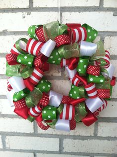 Love this wreath!!  It looks like a Christmas bow I've made for my girls!!  :)
