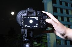 """How to photograph the moon: step 4 """"Switch your camera to Manual mode and your lens to manual focus. When choosing your camera settings, there are two key factors to remember: the moon is bright, so a low ISO is fine, and it's actually moving slowly, so a fast shutter speed is called for. We chose 1/200 sec, f/10 and ISO200"""""""