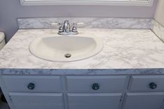 Transform your bathroom for only a few dollars with a contact paper countertop. You'll be amazed at how beautiful it looks & so will your fa… – DIY Bathroom – epo countertop kitchen Wooden Bathroom Vanity, Distressed Bathroom Vanity, Diy Bathroom, Concrete Bathroom, Bathroom Flooring, Bathroom Ideas, Hall Bathroom, Bathroom Countertop Cabinet, Bathroom Counter Decor