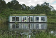 Lake house from upcycled shipping containers.  Love the rooftop garden.