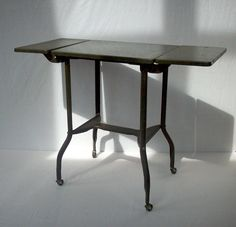Vintage Industrial Metal Work Table with Wheels and Fold Down Sides / Toledo Guild Products Inc. $66.00, via Etsy.