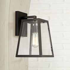 An Edison bulb adds to the industrial inspired look of this Mystic black finish outdoor wall light.