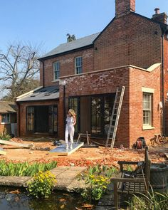 Black framed doors and windows (crittall style?) on a red brick house renovation. This is going to look gorgeous! Brick Siding, House Siding, Brick Extension, Extension Ideas, Red Brick Exteriors, House Exteriors, Cottage Extension, Brick Cottage, External Cladding