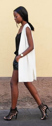 Sylvie Mus Black And White Vest Street Stylish Outfit Idea                                                                             Source