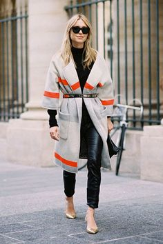 Blanket coat, leather leggings, and a metallic belt