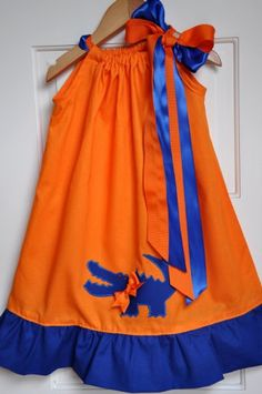 Gator Girl dress.. @Devon Slabaugh the mom's in g-ville would definitely pay you to make these!