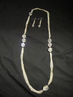 Silver chain necklace with clear beads and matching earrings