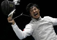 China's Lei Sheng celebrates defeating Egypt's Alaaeldin Abouelkassem in a men's individual foil gold medal fencing match.
